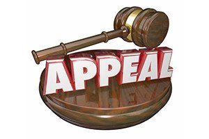 Appeal word in red letters on a wooden judge gavel