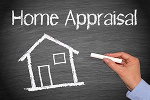 Home Appraisal - House with text and female hand with chalk