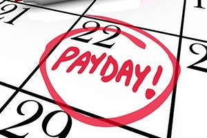 The word payday circled in red marker on a calendar