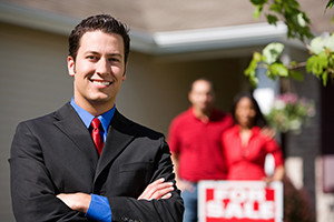 Real estate confident agent with home sellers