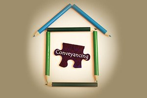 A house symbol make from color pencil and puzzle with word conveyancing