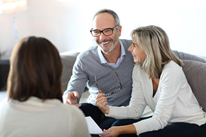 Senior couple meeting financial adviser