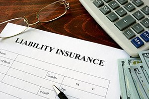 Liability insurance form and dollars on the table