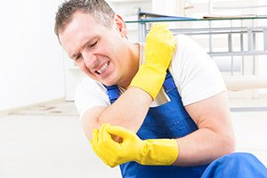 Man worker with elbow injury, concept of accident at work