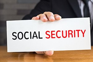 Social security, message on white card and hold by businessman