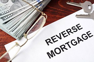 Reverse mortgage form on a table and money