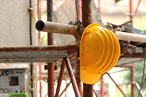 Yellow helmet on tubular scaffolding