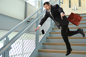 Businessman falling on stairs